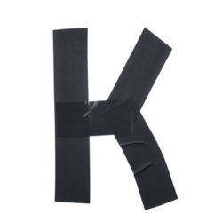 Letter K symbol made of insulating tape pieces, isolated over the white background